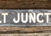 Holt Junction railway station sign