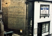 Advertisement on the Swan Hotel, Market Street, Bradford on Avon