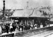 Bradford Station in 1875 with people waiting to welcome a visiting group.