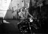 Joan Uncles and Eric Burgess on motorcycle