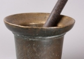 large bell-metal mortar with steel pestle