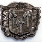 Hall's almshouse badge