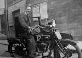 Jim King on an AJS motorcycle with sidecar
