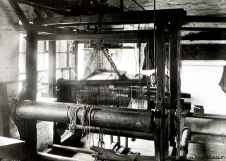 An old photograph of a hand loom, possibly in the Bradford area